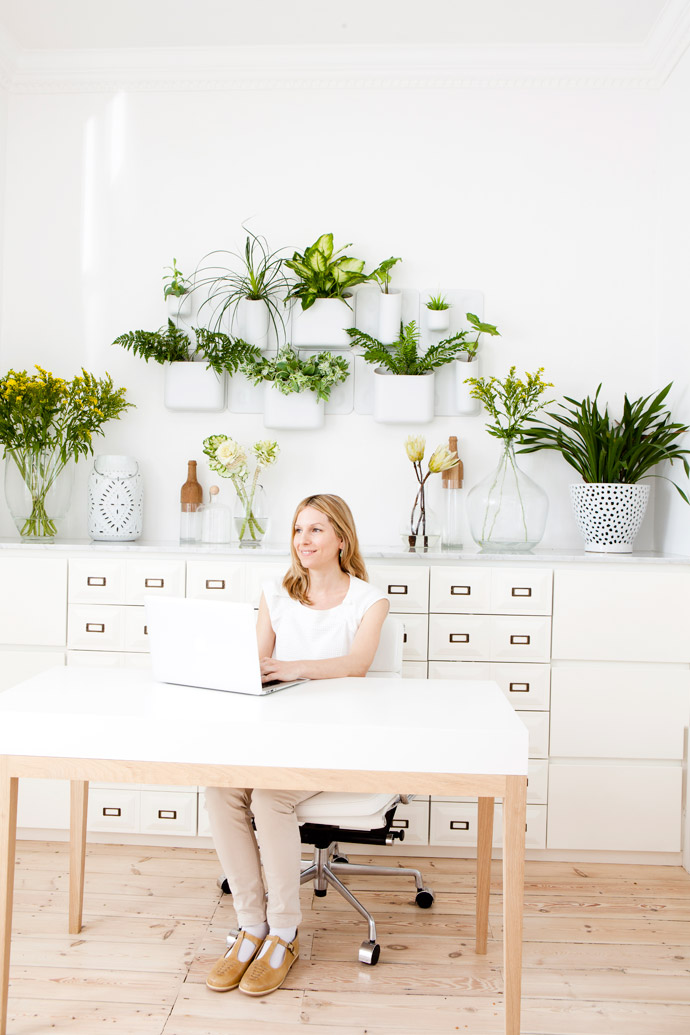 Dr Lulu Beyers in her consultation room. The plants and flowers (in a wall planter from Urbio and vases from Weylandts) add a touch of nature to the interior. TheChinese medicine dispensary was custom-made.