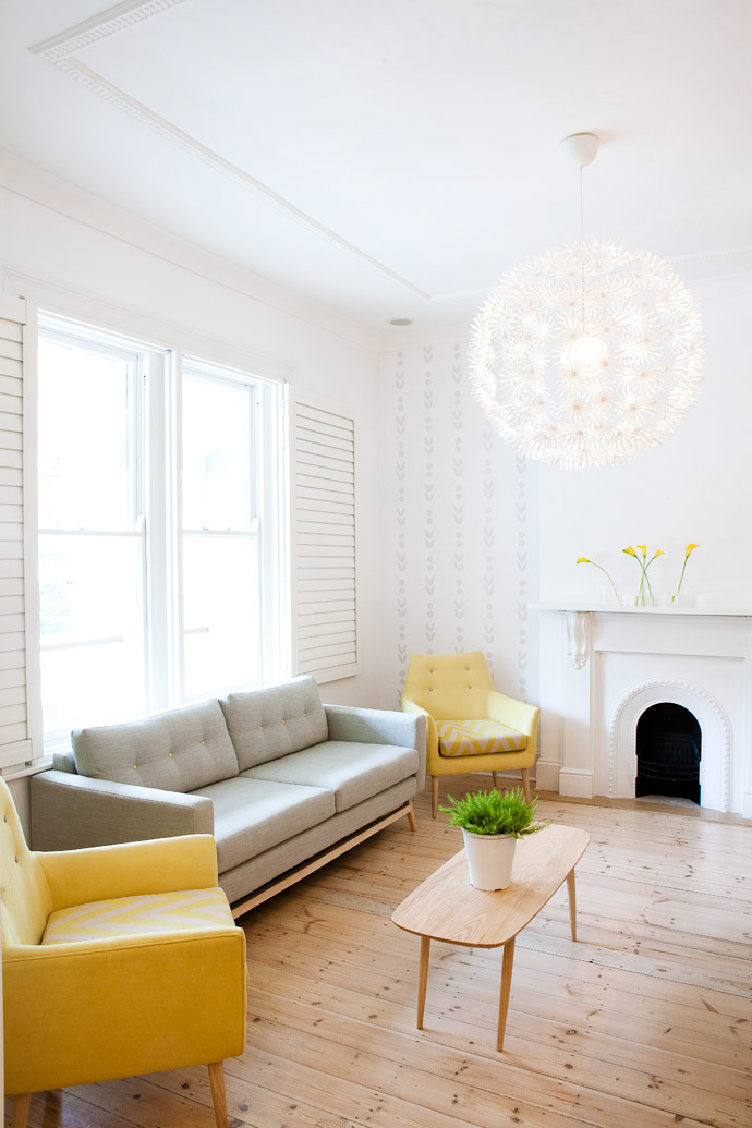 A pendant lamp from IKEA called Maskros (Swedish for Dandelion) is the focal point of the reception area. The sofa and chairs were custom-made to Lulu's specifications by DAGExclusive.
