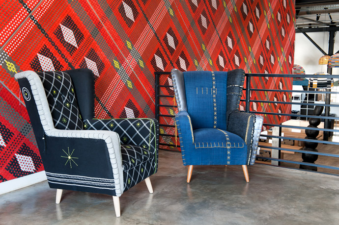 """The upholstered chair is a """"hand-crafted heirloom"""" byStarry Eve Collett from Casamento. Custom woven panels by John Vogel wrap the floating boardroom."""