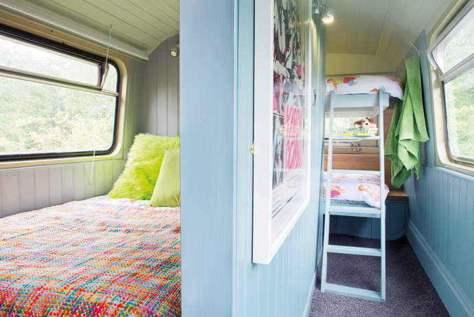 All the beds are on the upper deck, divided into their own neat rooms for extra privacy.