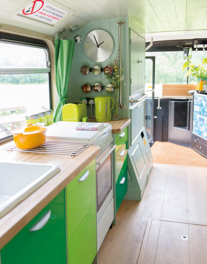 """Adam chose to cover the doors with a vivid green Perspex and add a solid oak worktop. """"It was the cheapest kitchen I could get. I like the fact I made something look rich that wasn't. The mix-and-match philosophy worked well, and it's like wearing a pair of designer jeans with a shirt from a supermarket."""""""