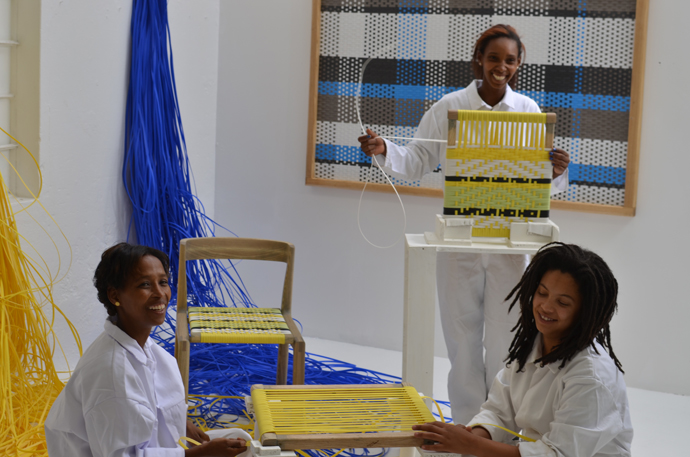 Woven panel and chair by John Vogel. The weavers, below from left, are Lizelle Andrews, Tishina Watson and Charnielle Davids. Image credit: Tracy Lynch.