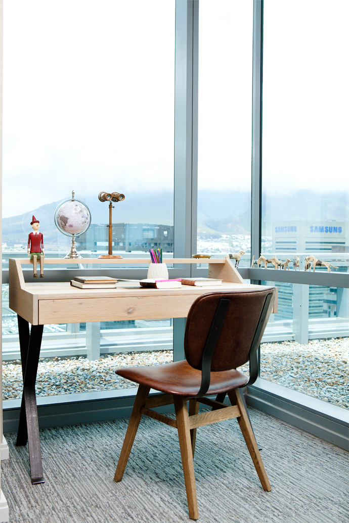 A study space with breath-taking views. The desk, chair and decor elements are from Weylandts.