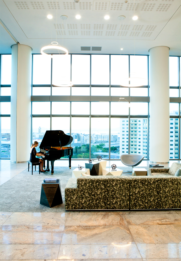 Sanja Murray tickles the ivories of the grand piano in the Sky Plaza on the eighth floor. The occasional chair and couch are by Comfort Creations. Black Sheep Interiors sourced the lighting, rugs and decorative elements.