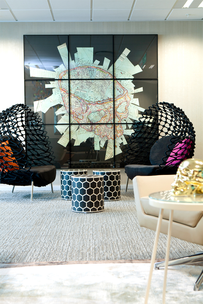 This striking mural is by Gerhard Marx and the Dragnet chairs, designed by Kenneth Cobonpue, are from Weylandts.