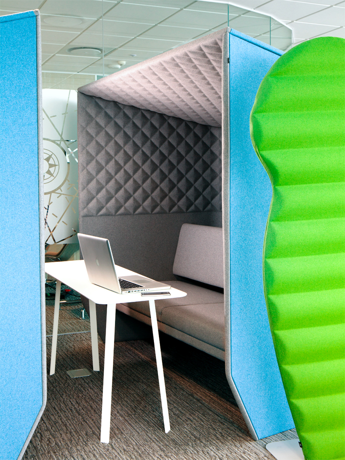 The BuzziBooth acoustic work booth and BuzziPlants screen provide sound insulation in an open-plan space. BuzziSpace acoustic products are imported by Love Office Life.