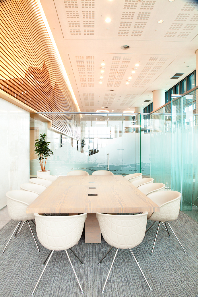 The bespoke boardroom table in a glass cubicle at the far end of the Sky Plaza is by Nowa.