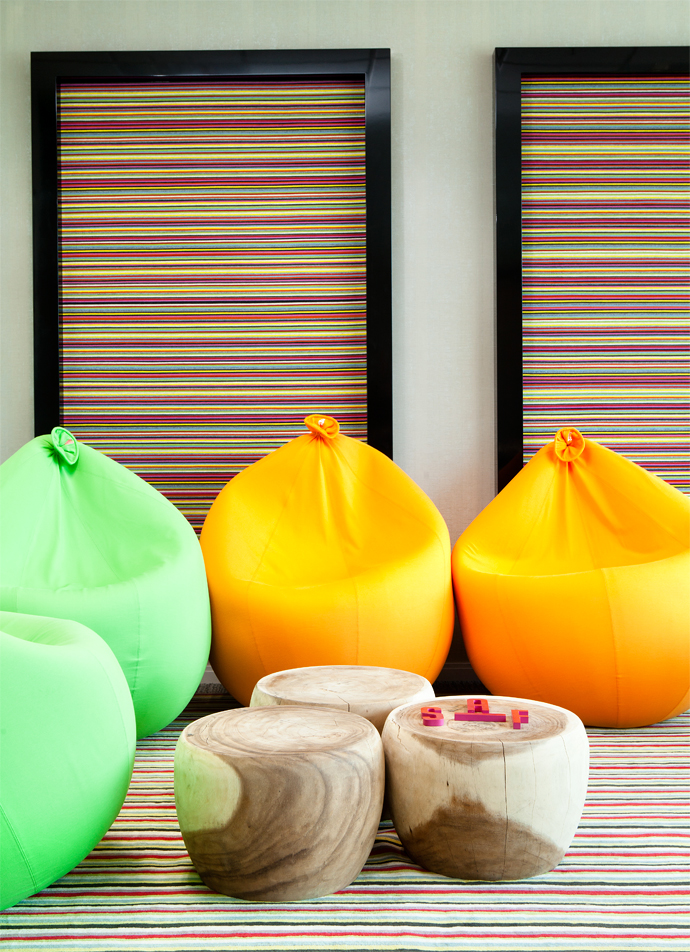 The Games Room, which features balloon-shaped bean bags imported by Black Sheep Interiors, is where staff get to collaborate in a lighthearted environment. The acoustic felt strip panels are by Paul Smit for Weaver's World.