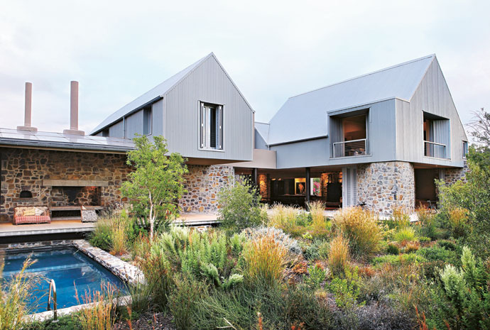 The house consists of four barn-like structures linked together with a