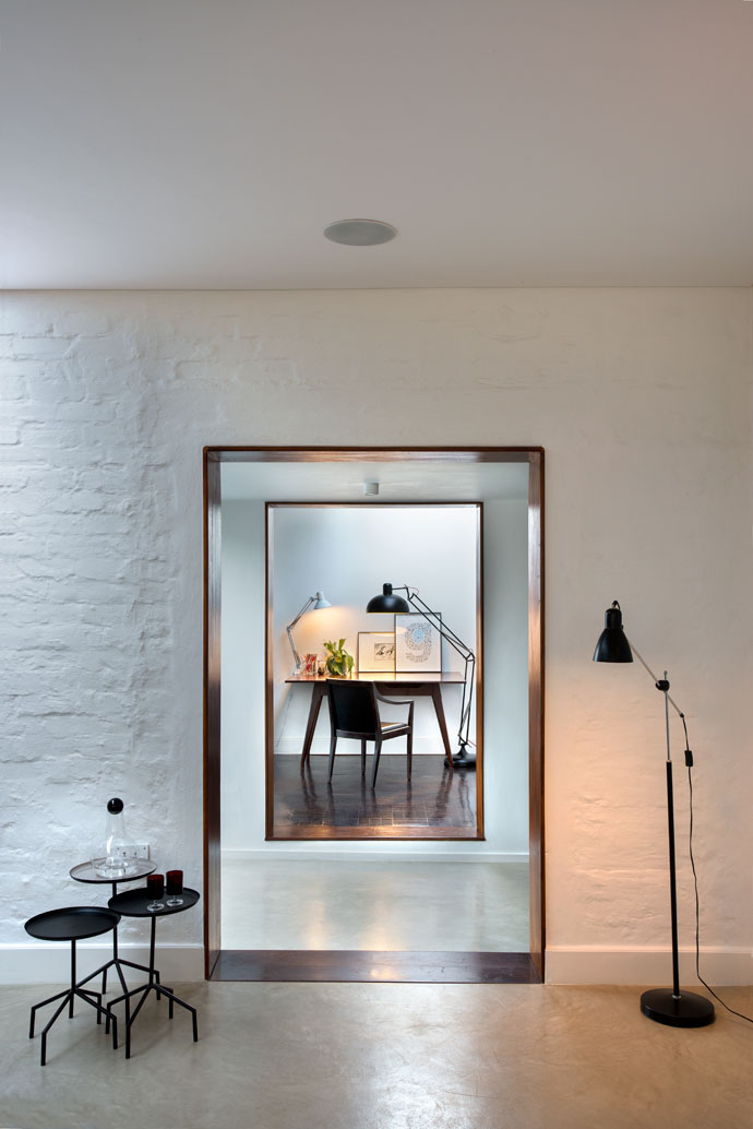 There were no period pieces in the original house to protect and preserve, besides the parquet flooring, which Christo and Nico used in their study. They opted for kiaat finishes to frame the doors. The wine decanter at the entrance of the lounge is from Design House Stockholm and the lamps are from Weylandts.