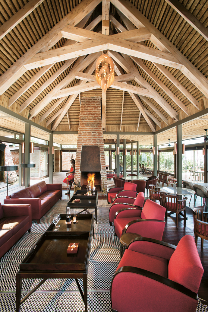 The main lounge takes its cue from the Muthaiga Club. The leather sofas are from Klooftique; the club chairs, tray tables and marble-topped tables from Woodcharm; the dining chairs from Odds & Ends; and the plastic woven rug from Jambo.
