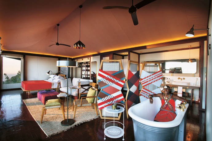 The bed, the side tables, the chair and footstool, and the Maasai/Gaultier-corset-inspired room divider are by John Vogel. The sofa, flanked by Dokter & Misses side tables, is by Woodcharm. The bath was custom-made for Angama Mara by Antique Bathrooms and the small table with the double top is by Fermob. The mirror that mimics the shape of a car's rear-view mirror is by Techpro in Nairobi and the hand-knitted rug from Heriz Gallery in Johannesburg.  And the lights allow you to read anywhere with ease without lighting up the Mara! The standard lights are from Heathfield & Co in London and the suspension lights from Copperwares in Harare.