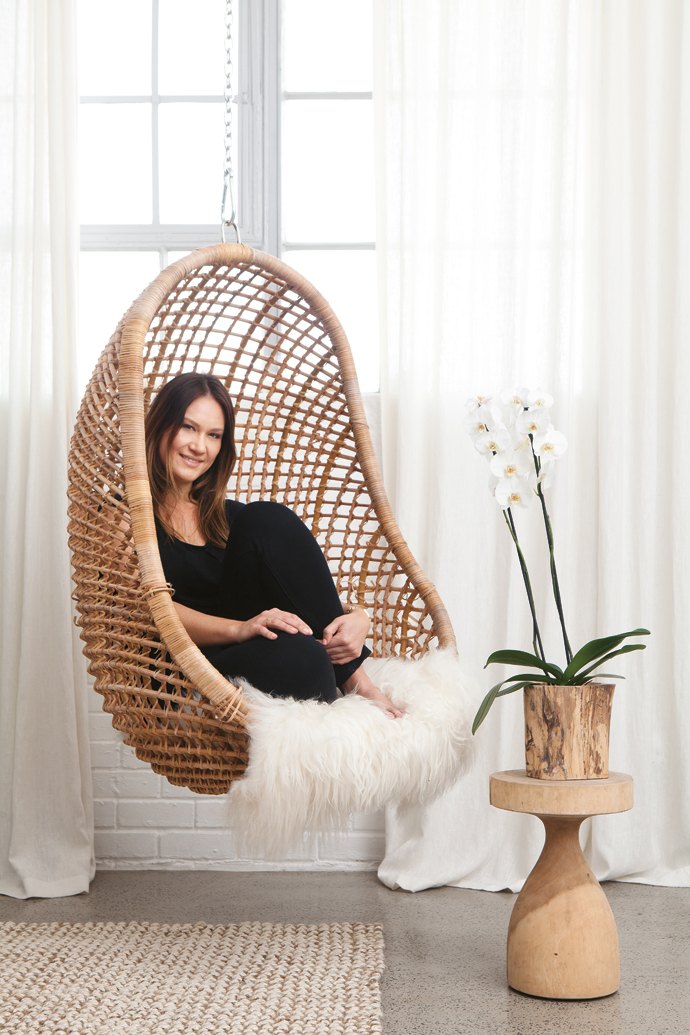 Lize likes to curl up in her suspended pod chair. She bought the Icelandic sheepskin throw in Copenhagen earlier this year.