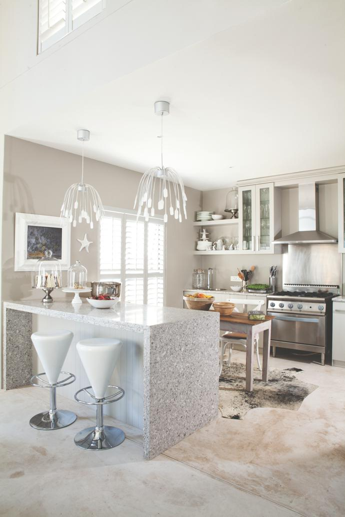 Hardy designed the kitchen around his very first stove, which came all the way from Boussac. Thehanging lamps are from Ikea Paris.