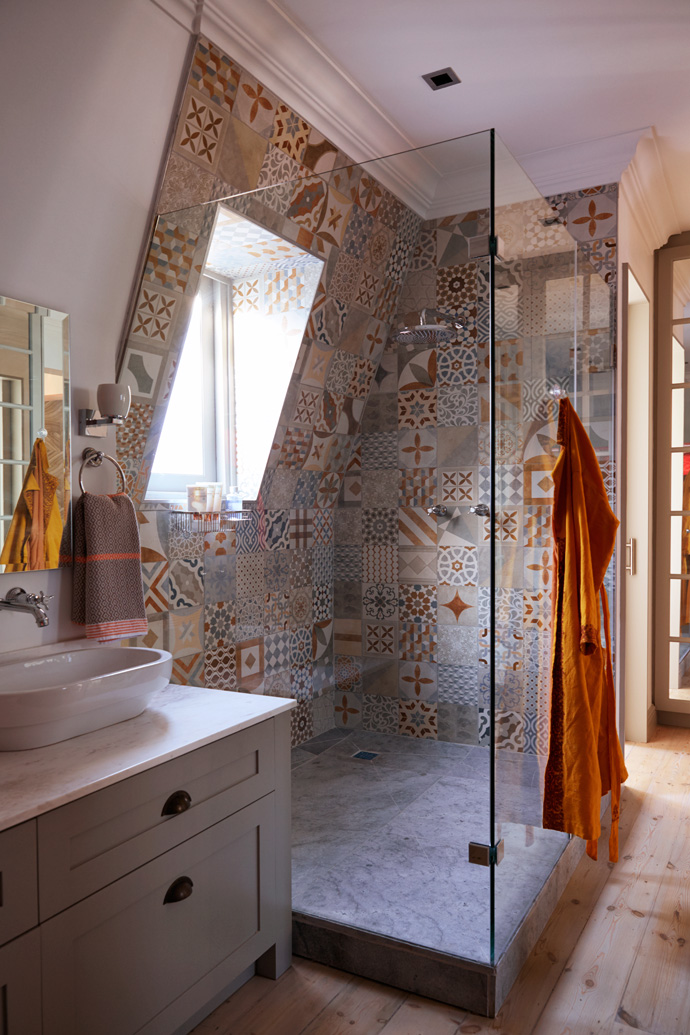 The master en-suite doubles as a walk-in closet. The shower tiles are from Italtile and the towels from Mungo.