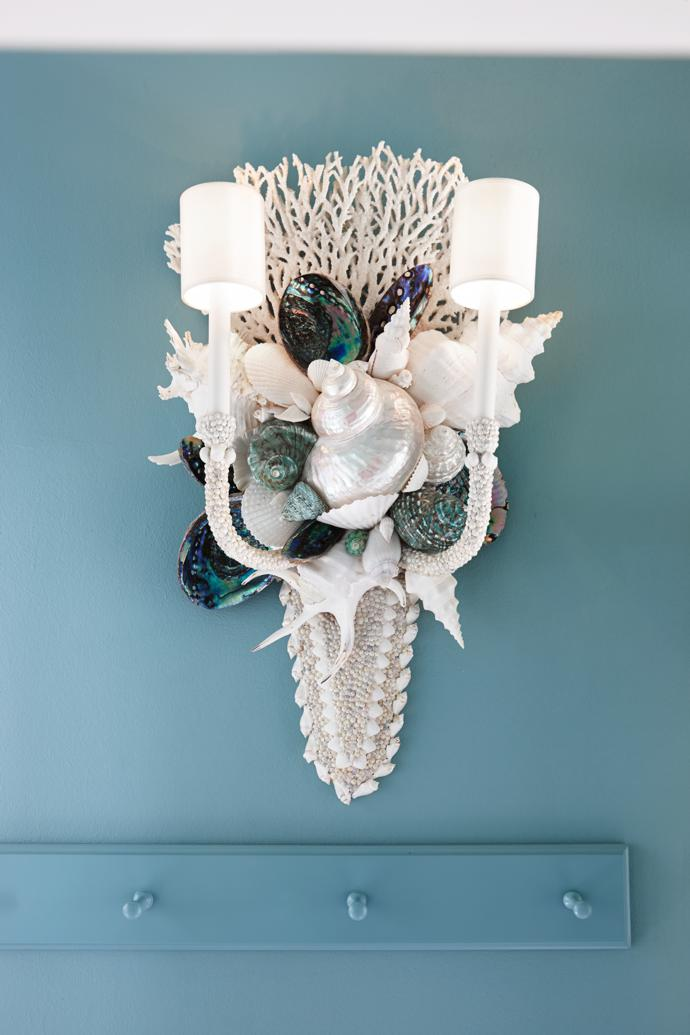 Blue abalone shells and coral feature in a sconce made by Thomas.