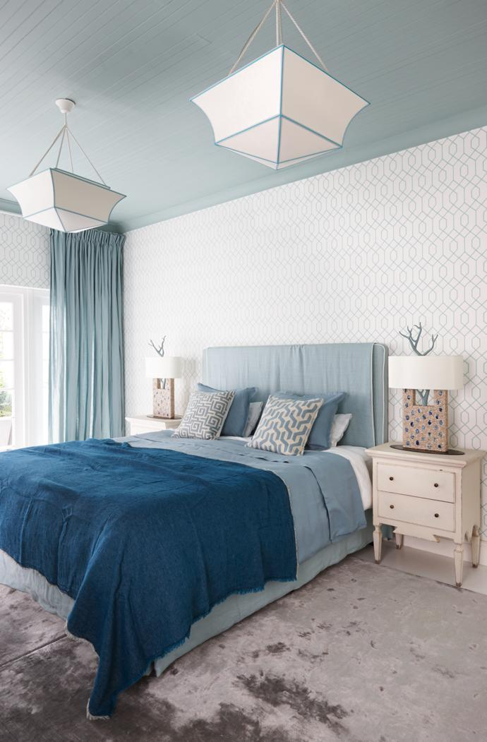 The headboard in the main bedroom is from Pezula Interiors, the bedside lamps and ceiling lights are by Thomas Boog Paris and the bamboo silk carpet is from Mae Artisan Rugs. Vintage Scandinavian bedside tables complete the picture.