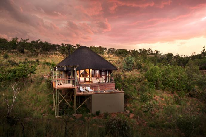 The romantic honeymoon suite is a real lover's nest with its own plunge pool, an outdoor bed for romance in the moonlight and views that stretch across the waterhole and reserve.
