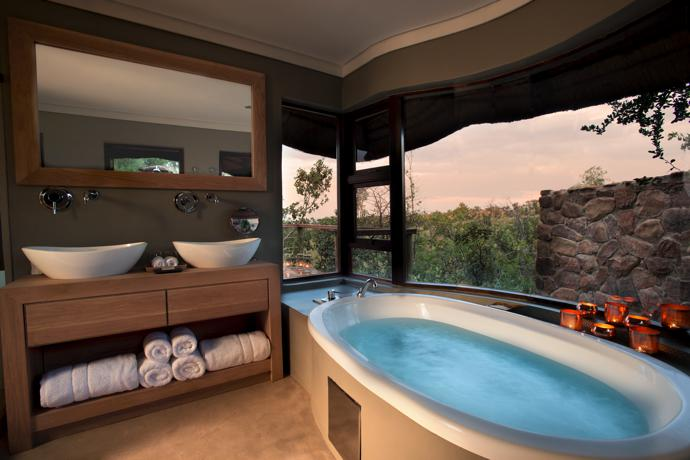 The sanctuary-like bathroom in one of the executive suites boasts an inside and outside shower, a bath with Bushveld views and double vanities.