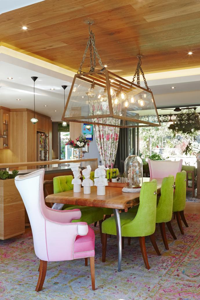 Dining at Berdine's happens on pink and lime chairs with sculptures in white by UK designer Kathy Dalwood. The chairs are by Moorgas & Sons, upholstered in Designers Guild Padua Peony fabric, and the light fitting is from The Gatehouse at Mavromac.