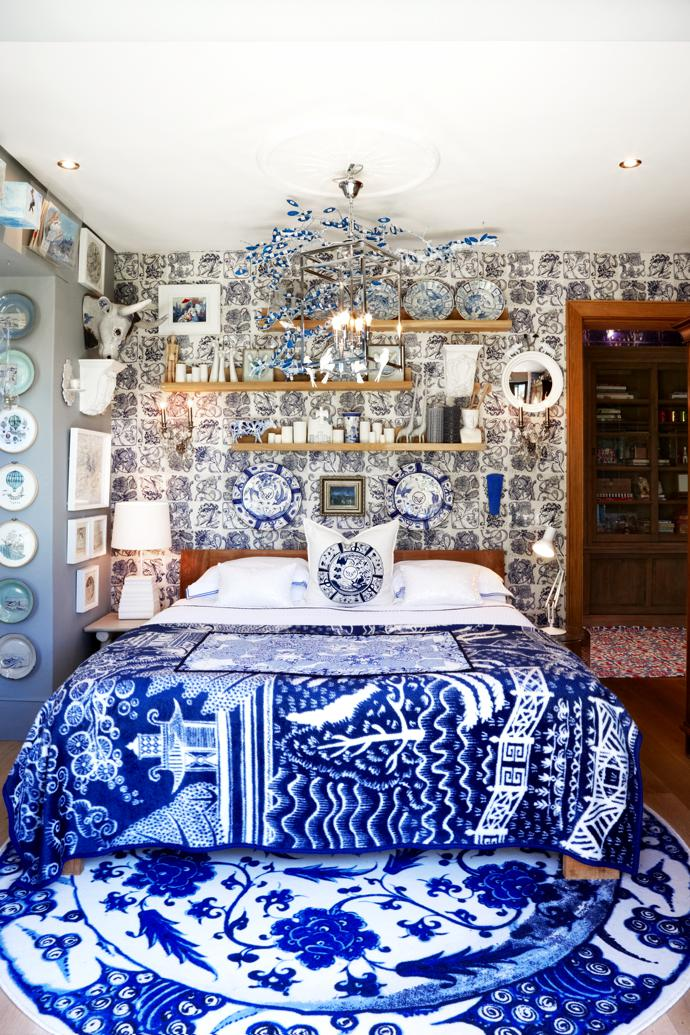 Behind the chandelier is Sarah Pratt's branch artwork Delft Tree Houses. The plate collection is by Margy Malan, and the blue plates and matching cushion are from Chandler House. The blanket is by Michael Chandler for MRP and the Delft Blue Plate rug by Marcel Wanders for Moooi. The wallpaper is by Ruan Hoffman for Anthropologie.
