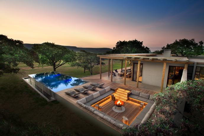The swimming pool is filled from a borehole that supplies the entire property. A step-down chill area, softly lit by striplights from Streamlight, was designed by Nicholas Plewman Architects. At its centre is a fire bowl from Amatuli. Next to the pool are iroko wood loungers by Meyer von Wielligh for GDF Design Lab.