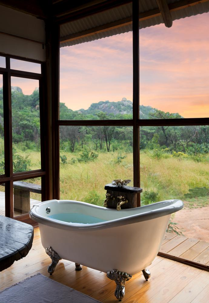 Bath with the best view. The tub is from Bathroom Boutique in Bulawayo and the rosewood wraparound doors and windows are from Timberland Doors and Windows in Bulawayo.