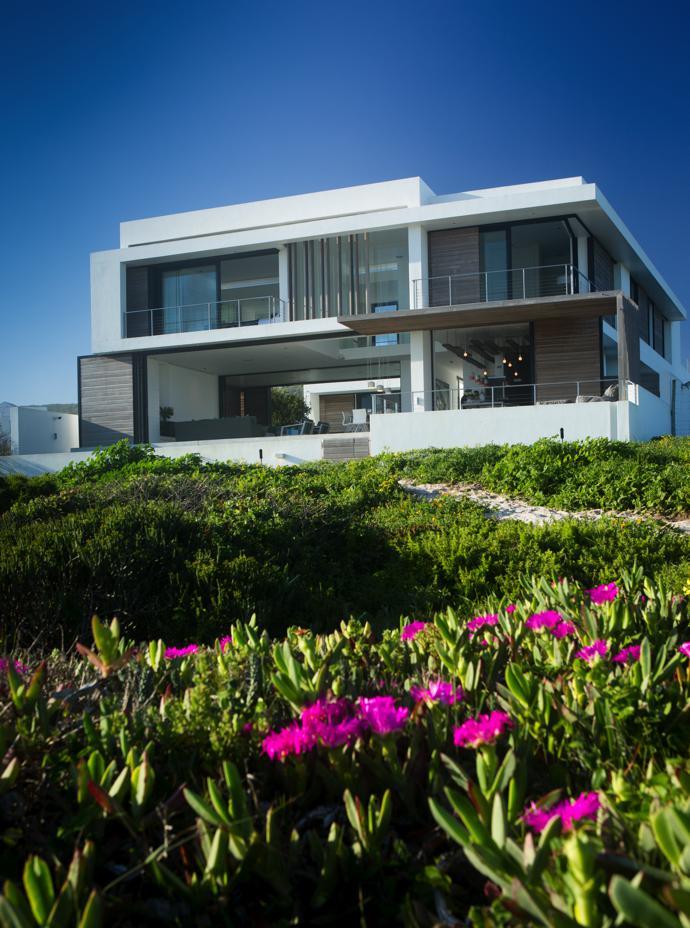 An indigenous garden by Yzerfontein Garden & Landscaping Services blends into the dune vegetation.