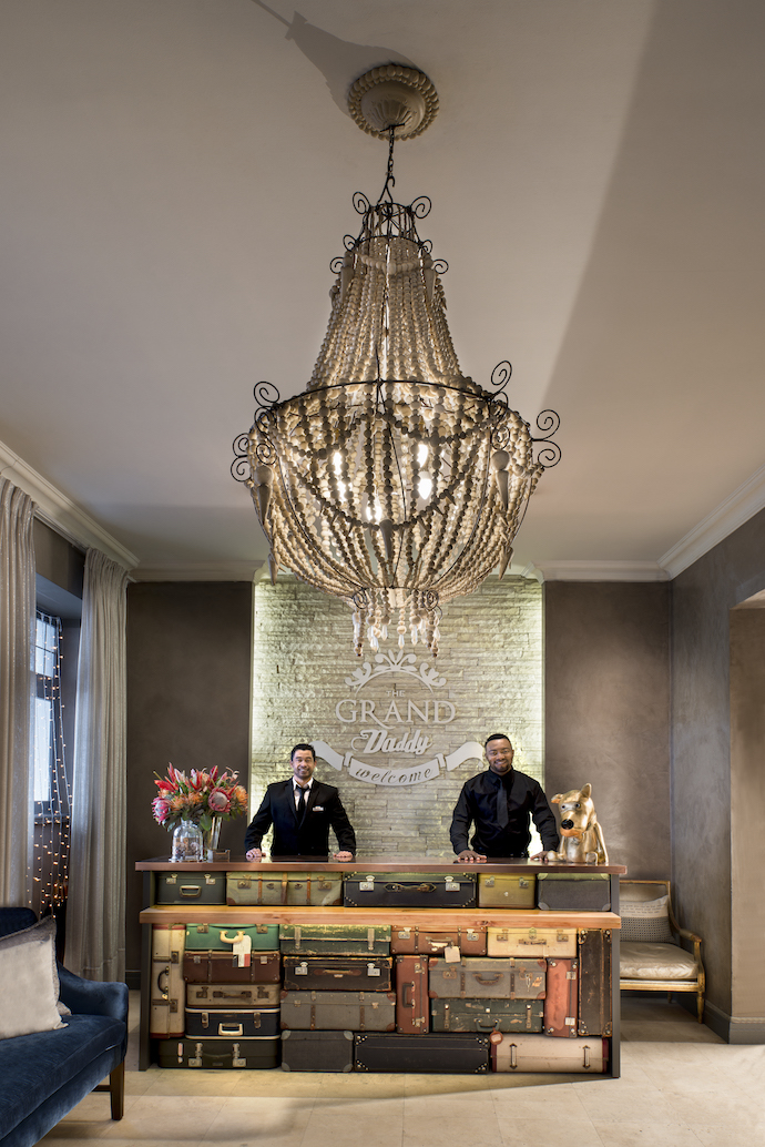 Yaseen Galvaan and Martin Ndibu welcome guests behind the bespoke counter by Beachhouse Interiors, made up of specially sourced vintage suitcases. The chandelier is by Mud Studio.