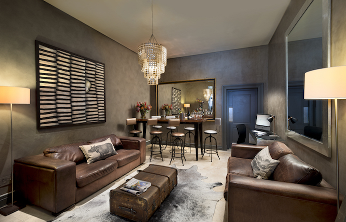 Guests can have meetings in the downstairs reception room around the custom designed copper table by Jacqui Hunter, or sit back on a leather sofa.