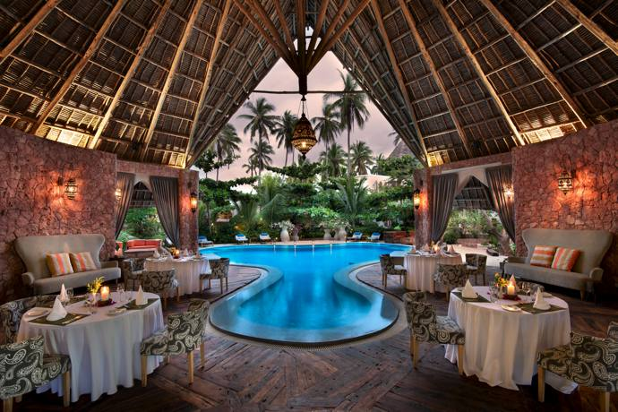 The main dining area with its makuti roof, fossilised-coral walls and mangowood wood floor.