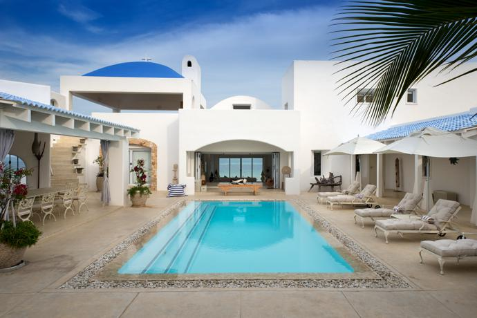 The entrance to the main villa, simply called The Villa, opens onto the pool courtyard.