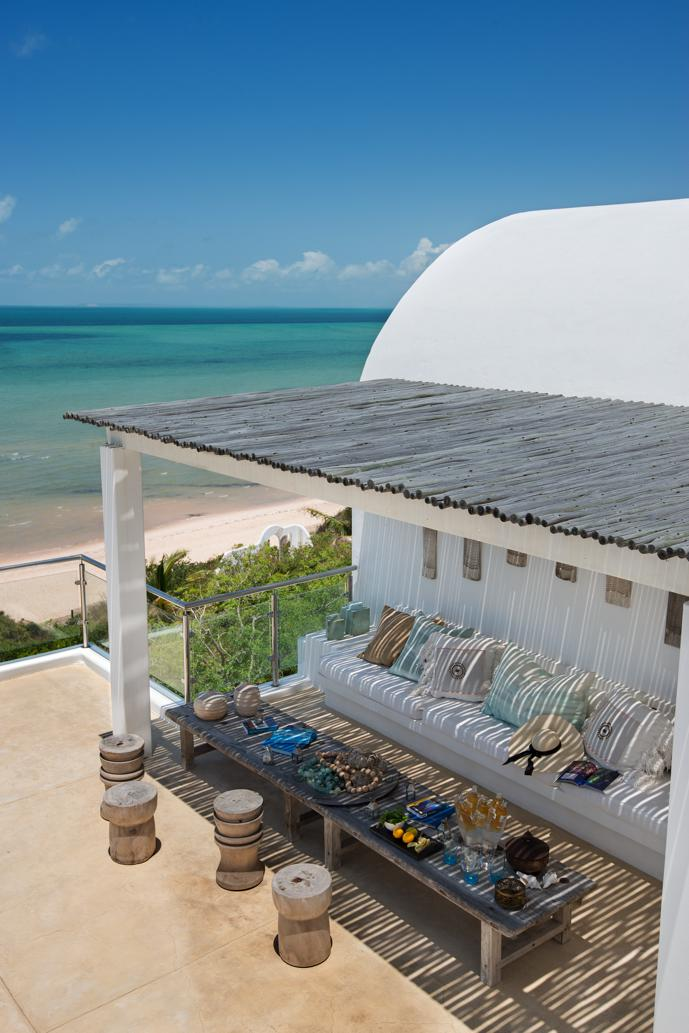 Villa da Praia's pool patio offers shade and lots of comfy cushions from Weylandts on built-in benches.