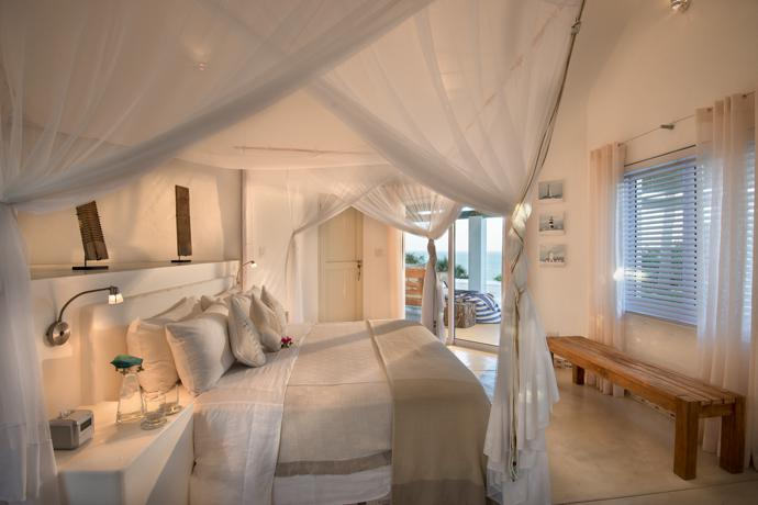 The Chapel's main bedroom has a romantic ambiance. All the beds at Santorini are built-in white cement platform beds.