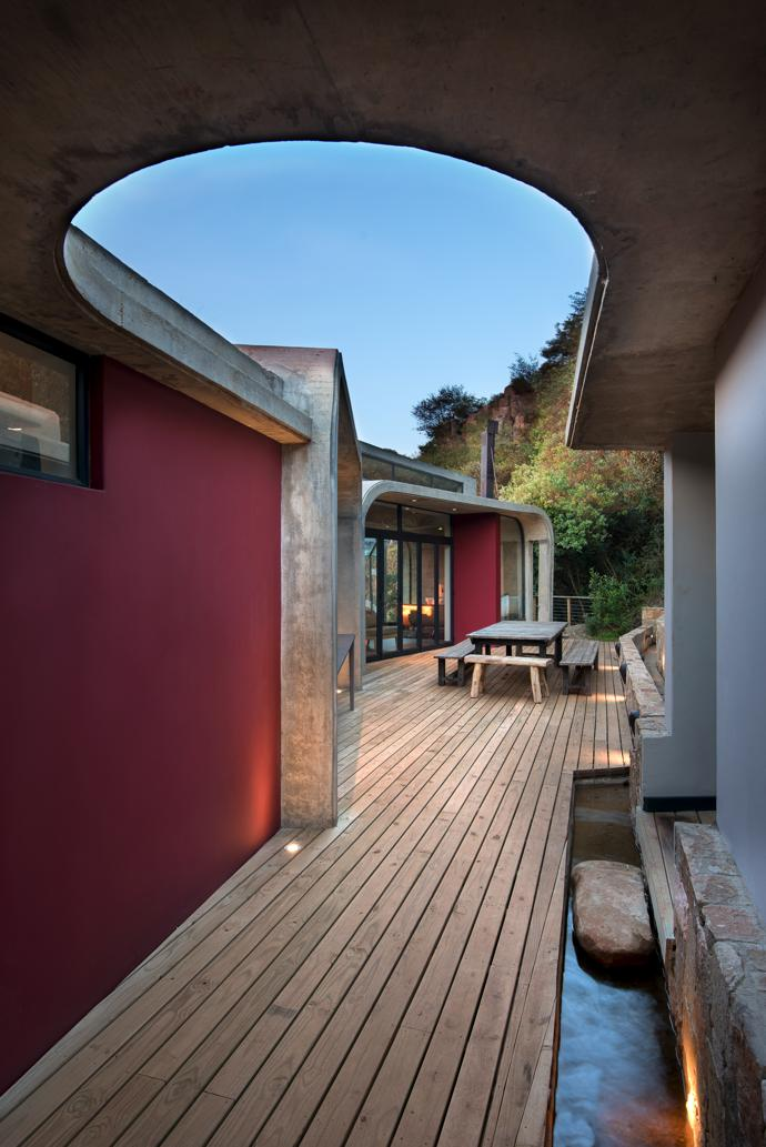 ... The Entrance Leads Into The Courtyard Between The House And An  Indigenous Forest At The Back