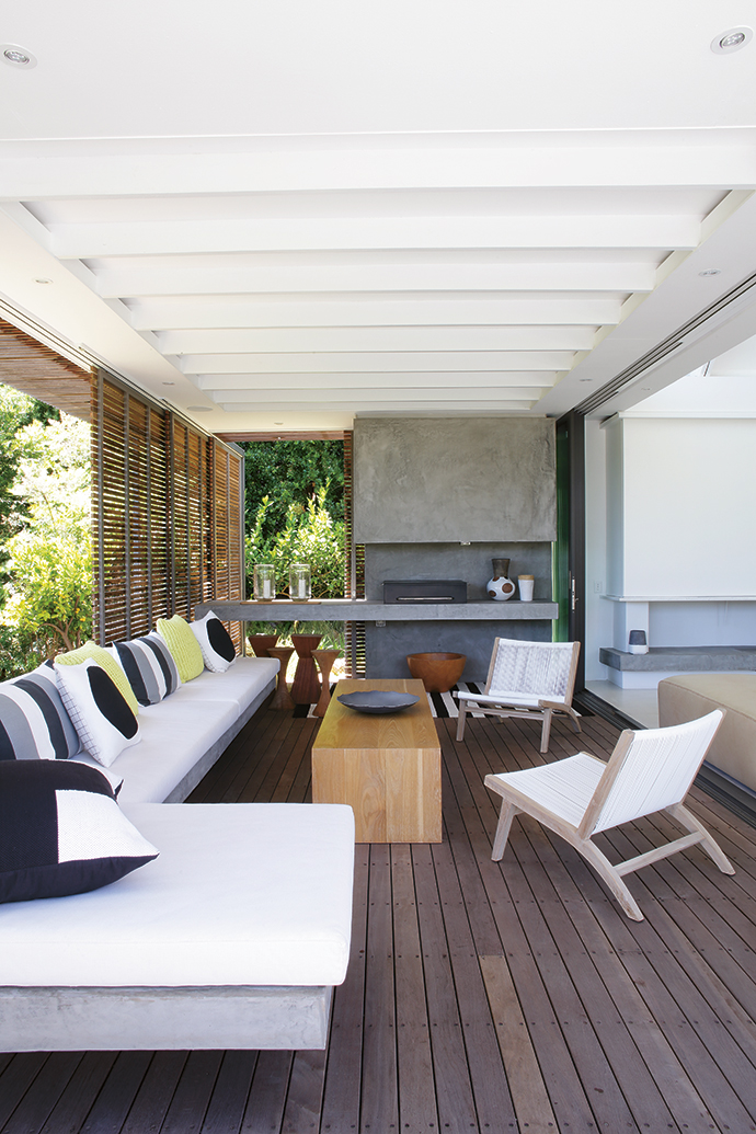 The fabrics for the outdoor built- in seating and entertainment area are from Crevin, a Spanish textile supplier, and the braai was custom-built by Schmidt Custom.