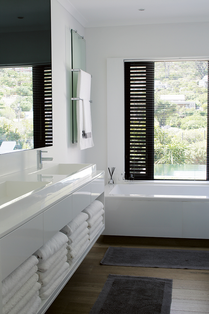 The bathrooms were modernised with contemporary fittings and concealed lighting, all on dimmers. The windows were enlarged to frame the garden and were fitted with shutters – the key unifying element of the design.