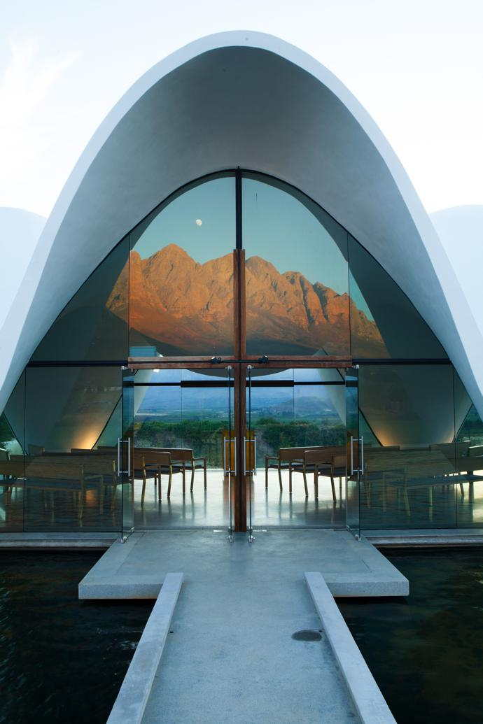 A narrow walkway across the pond leads to the entrance of the 120-seater glass-walled chapel, through which you can see the mountains.
