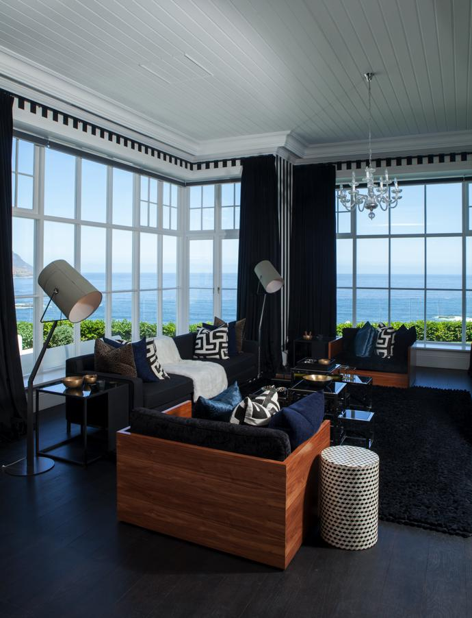 Michael Pixton-Taylor of Old Cape Wood Joinery made the custom-designed doors, interior shutters and 2,8 m-high sash windows in fine afrormosia timber, also called African teak, using traditional balanced weights. The Fork floor lamps in the informal family lounge are by Diesel with Foscarini.
