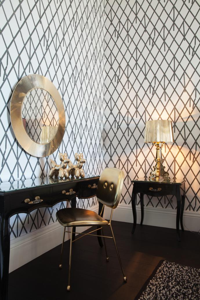 The black and gold accents of the custom-made Olàlà! Interiors bedroom suite is reinforced by Bourgie lamps and an All Saints mirror from Kartell, gold poodles and Nika Zupanc's The Golden Chair.