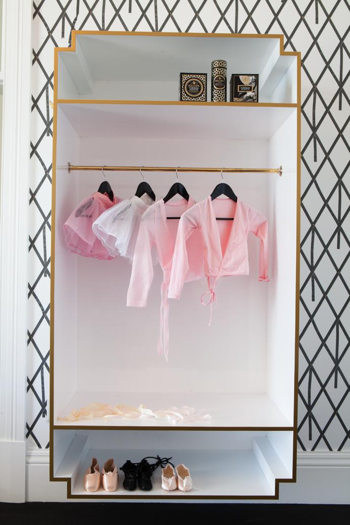 Schané played with a pale-pink Chanel theme in the little girl's bedroom. Ballet outfits and satin slippers are on display in the custom cabinetry by Olàlà! Interiors.