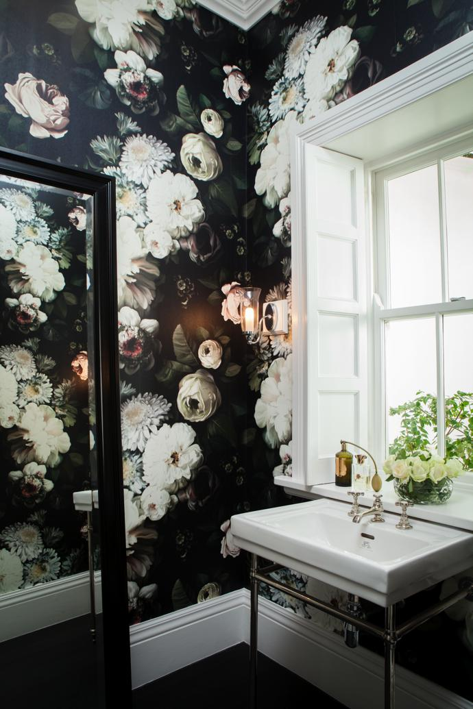 """My ultimate favourite wallpaper ever!"" is how Schané describes the baroque Dark Floral vinyl wall covering by Ellie Cashman in the guest bathroom."