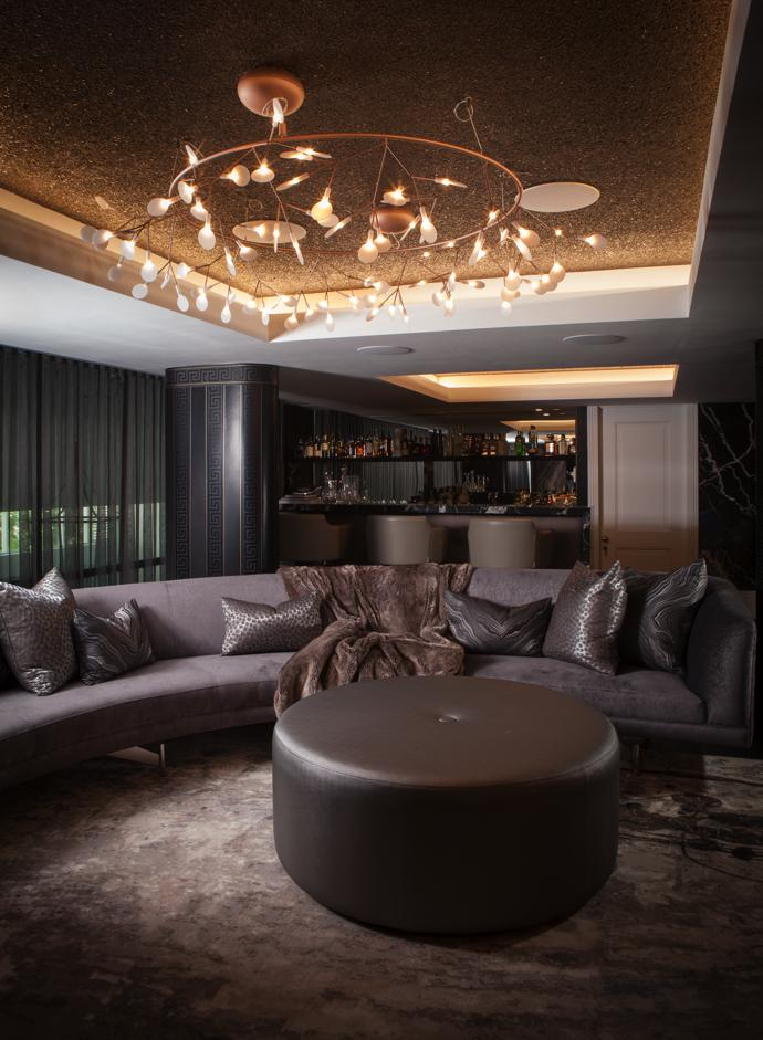 The pub and curved sofa were designed and manufactured by Olàlà's Luxoure brand. The striking pendant light, called Heracleum Big O, was designed by Bertjan Pot and Marcel Wanders for Moooi.