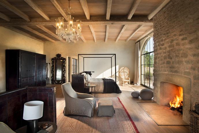 """The voluminous bedroom suites marry modern and ancient elements. The inviting """"messy bed"""" concept coexists with more traditional leather campaign-style wardrobes and bed screens, which LIFE designed and then had handstitched and waxed in Jaipur, India."""