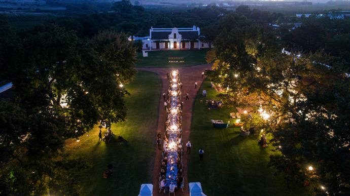 Every detail of the wedding celebration, such as the al fresco banquet at a long table in front of the Cape Dutch manor, served to transport guests to some place magical. It was an unforgettable experience.