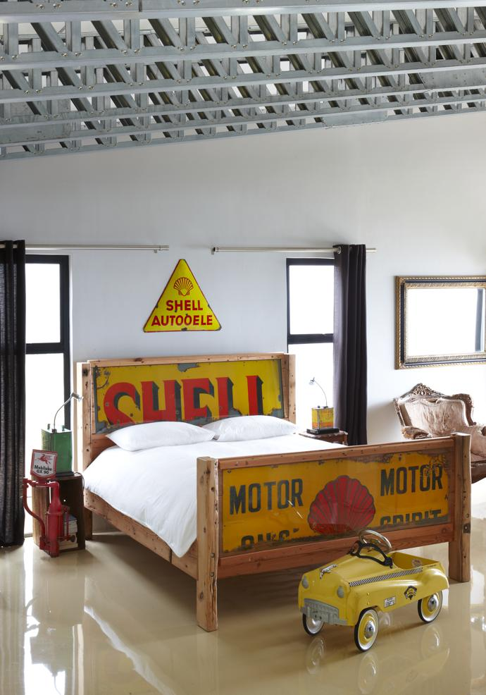 The bed is made of Oregon pine that came from a house – now torn down – that Dieter built in 1994. The 1920s partial Shell enamel signs, which are behind glass, used to be shack walls in a Namibian township.