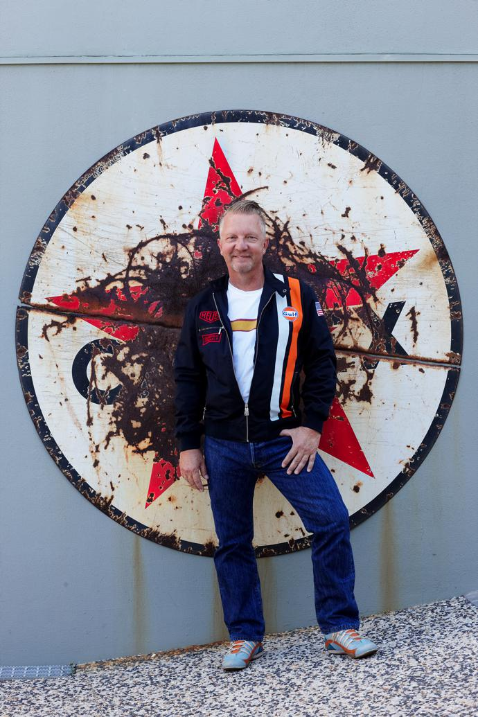 Man cave designer Dieter Losskarn in front of an enamel Caltex sign withcharacter. Join his Facebook group Rustworthy SA to find out where to get your hands on similar vintage treasures.