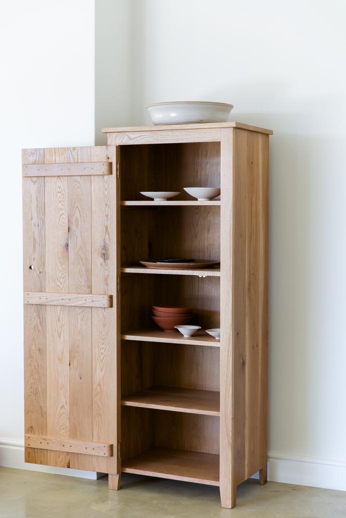 Skraal Kas, a tall, slim cupboard in oak, R12 995.