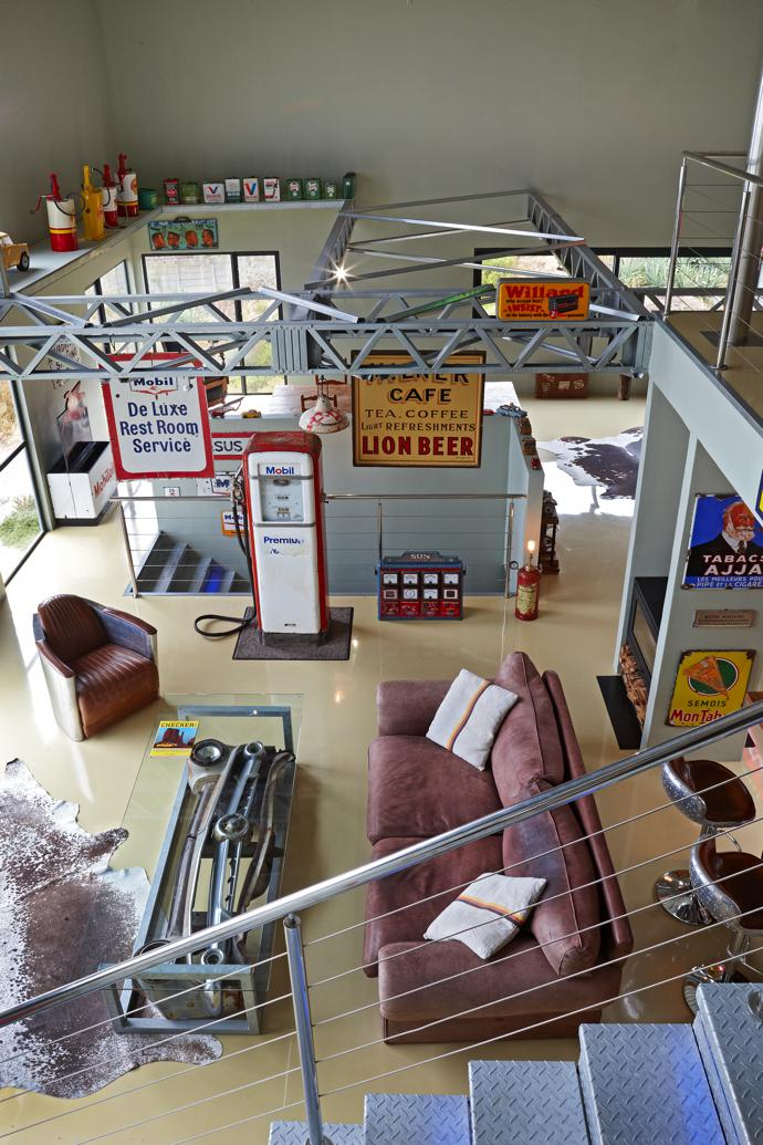 If he is not behind the wheel of a fast car, Dieter relaxes on his kudu-leather sofa next to the 1950s Gilbarco Mobilgas petrol pump. Various vintage enamel advertising signs are hanging from the steel trusses in the roof.