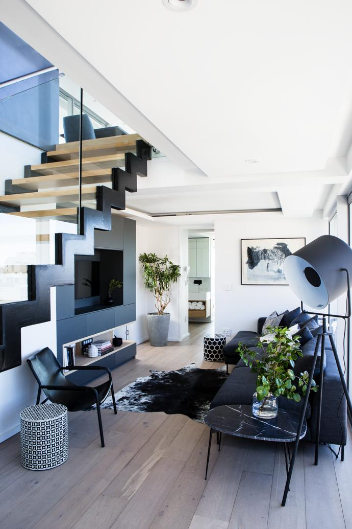 The penthouse was fully furnished by Weylandts Spaces in its signature style of urban minimalism. Artwork by Gwen van Embden.